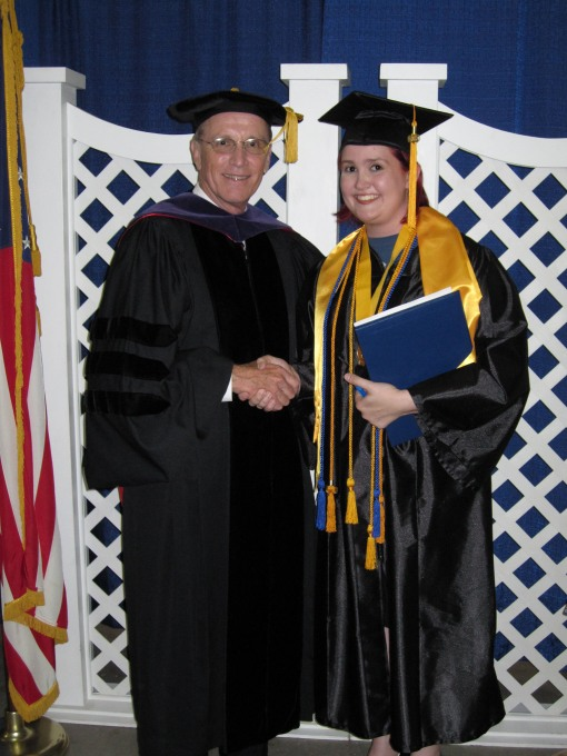 Dr. Bill Law, president of her college, with Favorite Daughter at graduation
